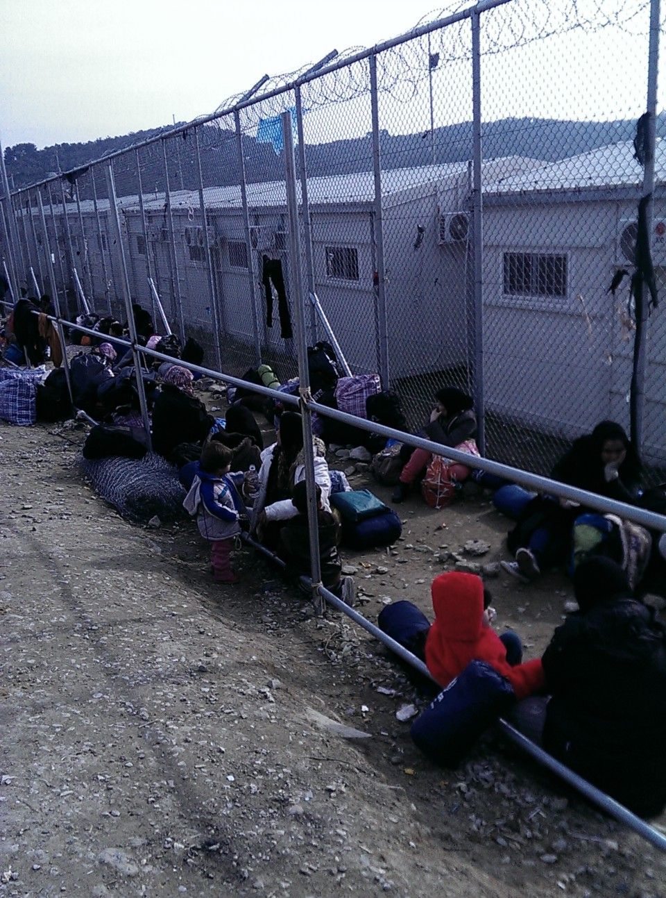 Afghan people, arrived the day before, forming a queue for the registration in Moria camp