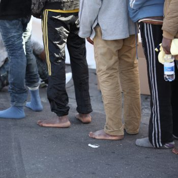 Catania, Sicily, April 23 2015. Over 220 people arrived at 8am by ship at the Sicilian port. Catania RC set up a clinic to offer medical treatment, psychosocial support and counseling along with fresh water and shoes for migrants.