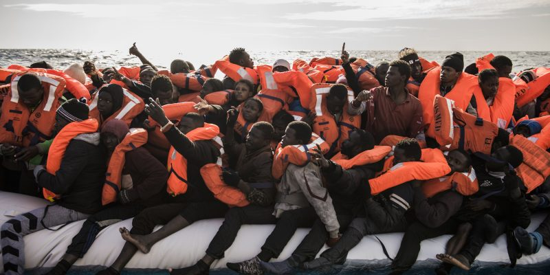 A rubber boat crowded with 125 people rescued at sea by the SOS Mediterranee crew. The moment of the transfer is the most dangerous. (photo: Federica Mameli/Luz)