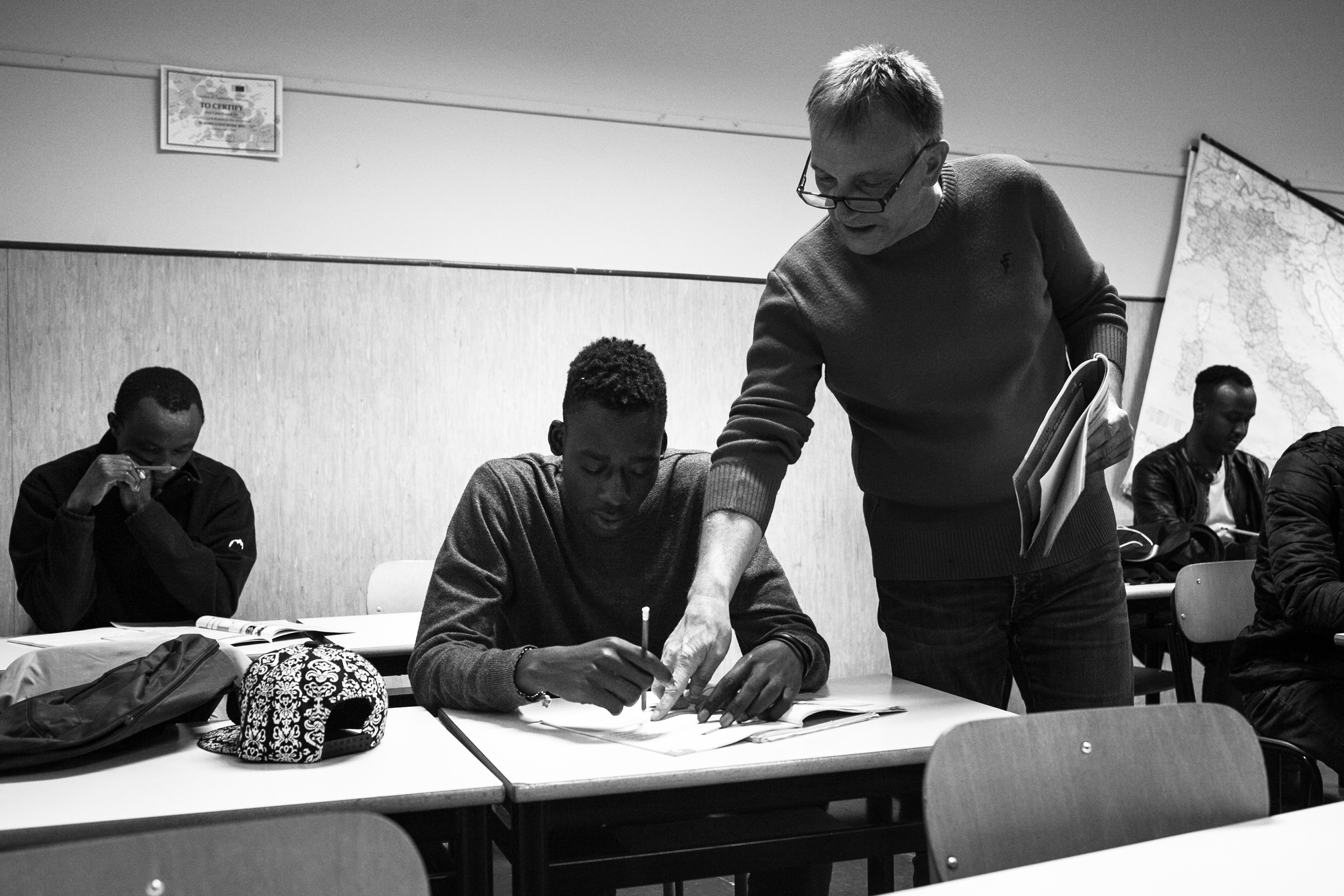 Malick, along with his colleagues from Hotel Colibri as well as from other migrant centers in Biella, attending Italian classes. All migrants receive Italian classes twice a week, in which they learn basic conversational skills to get on in their daily lives, as well as how to prepare their CV. (Photo: César Dezfuli)