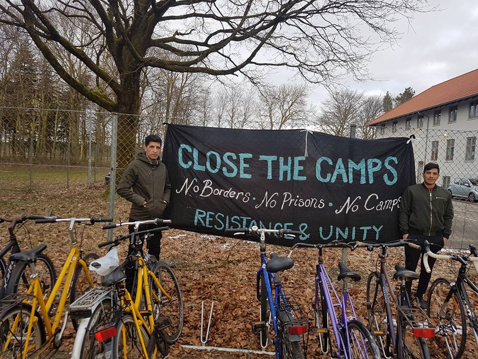 A banner outside Kærshovedgård detention camp in Denmark.