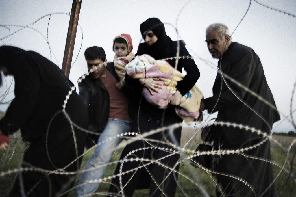 (Siriani in fuga verso la Turchia. Foto: Andreas H. Landi)