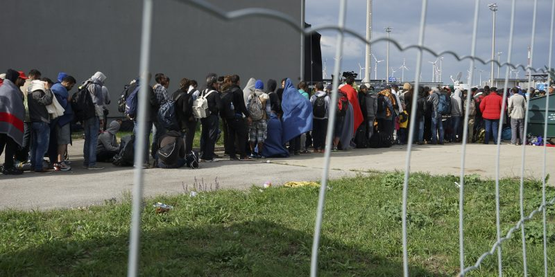 A line of Syrian refugees crossing the border of Hungary and Austria on their way to Germany. Hungary, Central Europe, 6 September 2015.