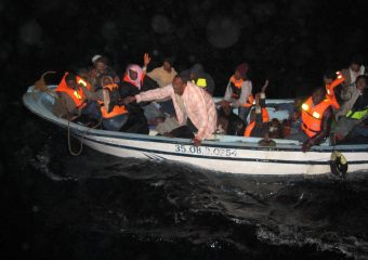 A small boat carrying  migrants arrives on Greek territory after crossing from Turkey.    Photo by courtesy of Hellenic Coast Guard / 2009